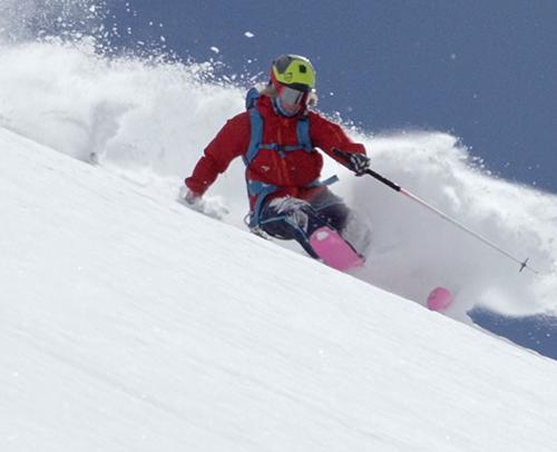 Man snowboarding down a hill.