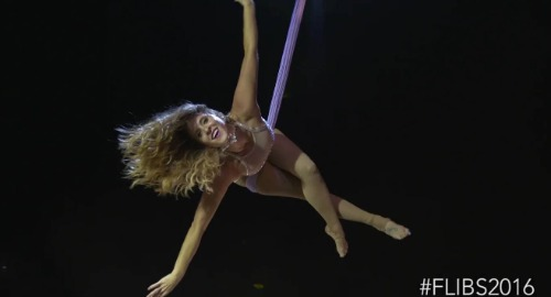 Trapeze artist performing.