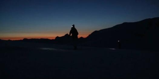 Man waling at dusk in winter.