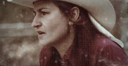 Faded picture of a woman wearing a cowboy hat.